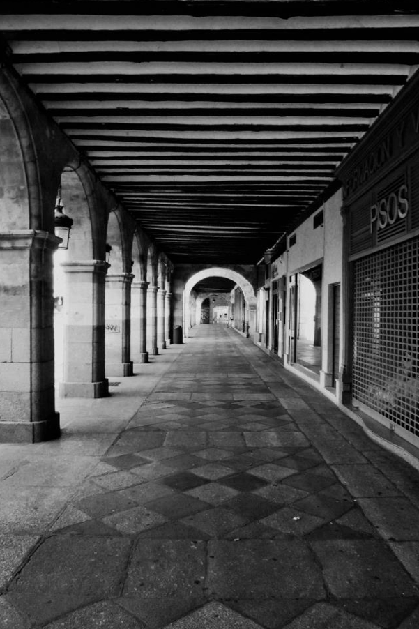 """Part of the collonaded walkway that surrounds the Plaza Mayor at Salamanca."""